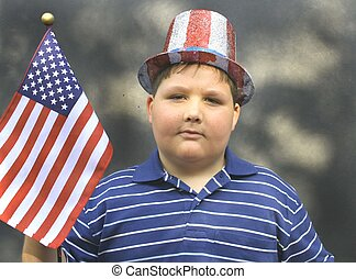 Young boy wearing 4th of july hat