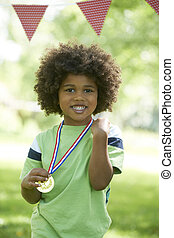 Young Boy Winning Medal At Sports Day