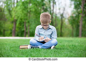 young boy with a books