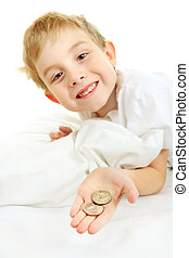 Young boy with a lost tooth, holding money from the tooth...