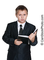 Young boy with a notebook