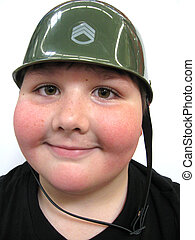 Young boy with army helmet on