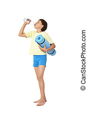 Young boy with bottle of water and mat