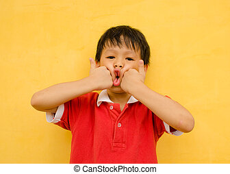 young boy with funny face