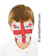 Young boy with georgia flag painted on his face