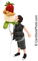 Young Boy with Giant Fork Eating Peanut Butter, Banana and Strawberry with Clipping Path