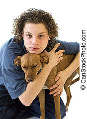 Young boy with his little brown dog