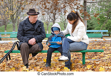 Young boy with his mother and grandfather