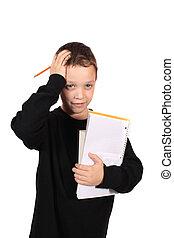 Young boy with homework headache