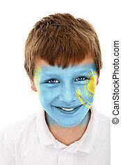 Young boy with kazakhstan flag painted on his face