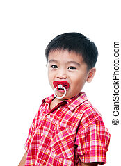 Young boy with pacifier in mouth