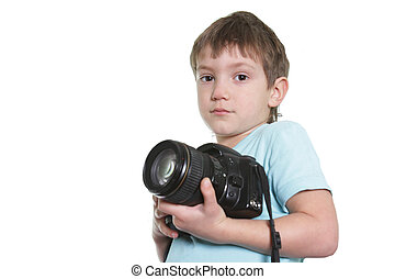 young boy with photocamera over white