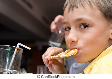 young boy with pizza