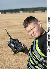 Young boy with radio control - young boy with radio control...