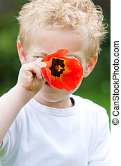 Boy with red flower