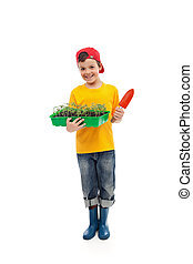 Young boy with seedlings ready for gardening