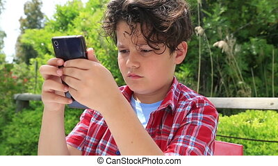 Young boy with smartphone 2