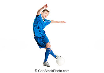 Young boy with soccer ball doing flying kick, isolated on...