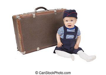 Young boy with suitcase