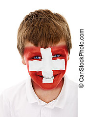 Young boy with switzerland flag painted on his face