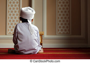Young Boy with Turban inside mosque