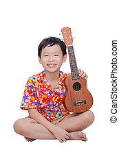 Young boy with ukulele over white