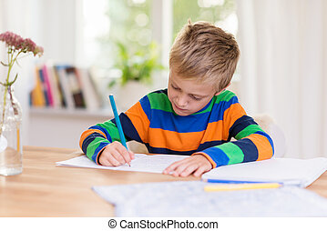 Young boy working on his class homework