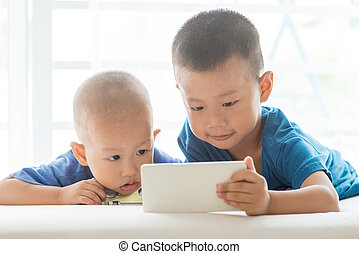 Young boys addicted to smart phone.