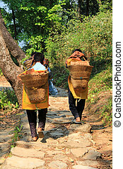 Young boys carrying baskets - Young boys carrying hand...