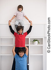 young boys posing line up piggyback - happy young boys ...