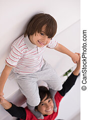 young boys posing line up piggyback top view - happy young ...