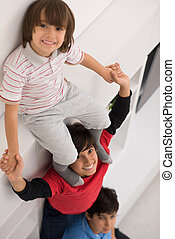 young boys posing line up piggyback top view