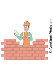 Young bricklayer working with spatula and brick.