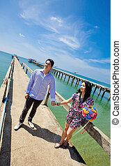 young bride and groom on fisherman pier with beautiful sky