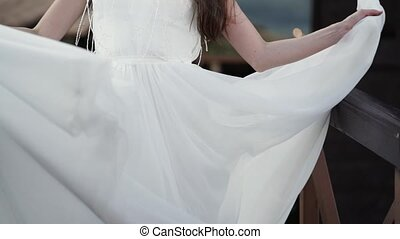 Young bride circling outdoors slowmotion