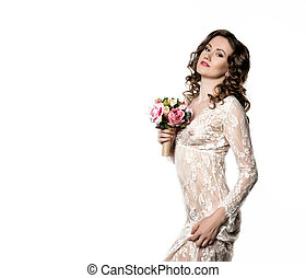 young bride in a white transparent dress holding bouquet. morning of the bride or spring girl with flowers. free space for your text