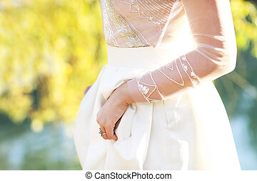 Young bride in white wedding dress outdoors