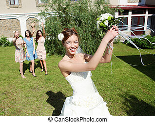 Young bride in white wedding dress