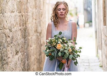 Young bride portrait with a wedding bouquet