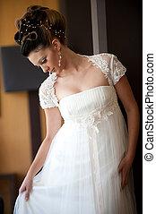 young bride posing looking down