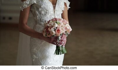 Young bride posing with flowers