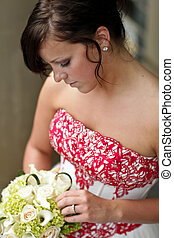 Young Bride - Beautiful bride looking down at her flowers
