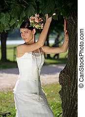 Young bride under tree