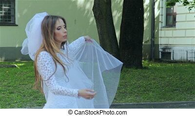 Young bride walking in park