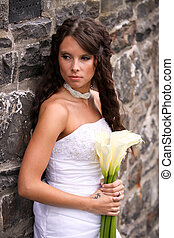 Young Bride with Lilies - A young bride against an old stone...