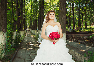 Young bride with red bouquet