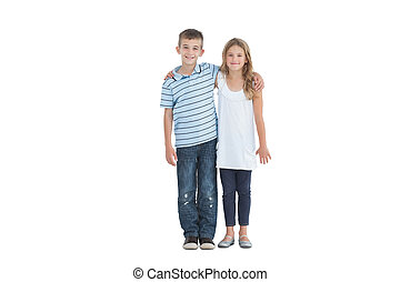 Young brother and sister holding each other
