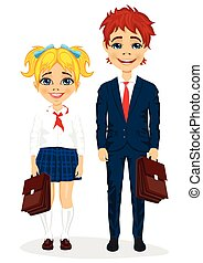 young brother and sister with suitcases standing together in school uniform