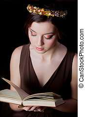Young brunet girl with wreath and book