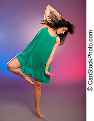 Young brunette caucasian woman dancing